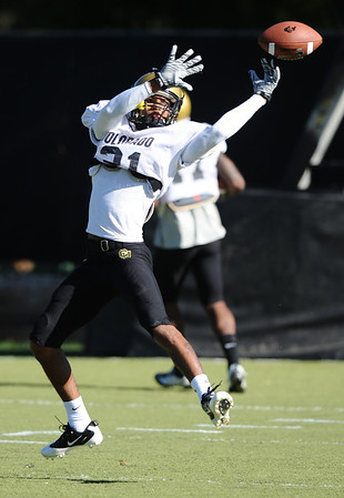 CUFOOT<br /> Wide receiver Keenan Canty runs drills at CU practice on Tuesday.<br /> Photo by Marty Caivano/Camera/Aug. 10, 2010