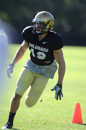 CUFOOT<br /> Safety Travis Sandersfeld runs drills at CU practice on Tuesday.<br /> Photo by Marty Caivano/Camera/Aug. 10, 2010