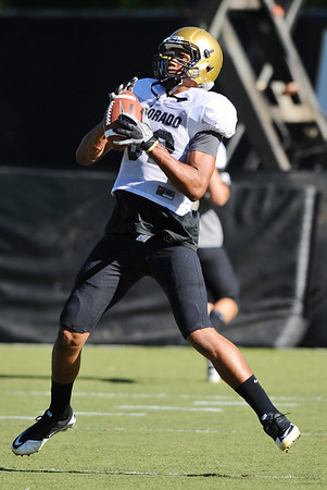 CUFOOT<br /> Wide receiver Jarrod Darden does drills at CU practice on Tuesday.<br /> Photo by Marty Caivano/Camera/Aug. 10, 2010