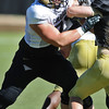 CUFOOT<br /> Offensive guard Eric Richter blocks Patrick Mahnke at CU practice on Tuesday.<br /> Photo by Marty Caivano/Camera/Aug. 10, 2010