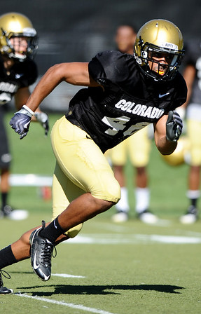 CUFOOT<br /> Safety Anthony Perkins works during kick return drills at CU practice on Tuesday.<br /> Photo by Marty Caivano/Camera/Aug. 10, 2010
