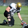 CUFOOT<br /> Center Keenan Stevens does drills at CU practice on Tuesday.<br /> Photo by Marty Caivano/Camera/Aug. 10, 2010