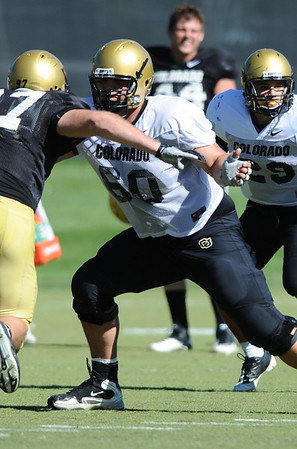 CUFOOT<br /> Offensive lineman David Clark blocks at CU practice on Tuesday.<br /> Photo by Marty Caivano/Camera/Aug. 10, 2010