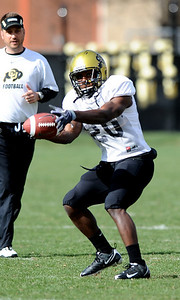 FOOTBALL Tailback Brian Lockridge makes a catch during practice Tuesday. Photo by Marty Caivano/Camera/March 30, 2010