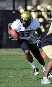 FOOTBALL Wide receiver Toney Clemons runs the ball during Tuesday's practice. Photo by Marty Caivano/Camera/March 30, 2010