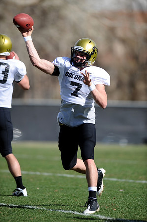 FOOTBALL<br /> Quarterback Cody Hawkins makes a pass during practice Tuesday.<br /> Photo by Marty Caivano/Camera/March 30, 2010