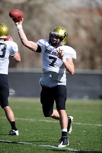 FOOTBALL Quarterback Cody Hawkins makes a pass during practice Tuesday. Photo by Marty Caivano/Camera/March 30, 2010