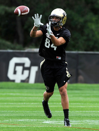 "University of Colorado receiver David Bagby makes a catch during football practice on Monday, Aug. 6, at the CU practice field in Boulder. For more photos of the practice go to  <a href=""http://www.dailycamera.com"">http://www.dailycamera.com</a><br /> Jeremy Papasso/ Camera"