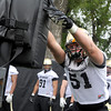 "University of Colorado defensive lineman John Tuso hits the sled during football practice on Monday, Aug. 6, at the CU practice field in Boulder. For more photos of the practice go to  <a href=""http://www.dailycamera.com"">http://www.dailycamera.com</a><br /> Jeremy Papasso/ Camera"