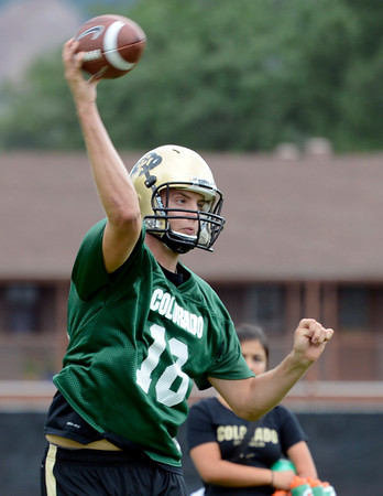 "University of Colorado quarterback Stevie Joe Dorman passes the ball during football practice on Monday, Aug. 6, at the CU practice field in Boulder. For more photos of the practice go to  <a href=""http://www.dailycamera.com"">http://www.dailycamera.com</a><br /> Jeremy Papasso/ Camera"