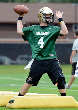 "University of Colorado quarterback Jordan Webb passes the ball during football practice on Monday, Aug. 6, at the CU practice field in Boulder. For more photos of the practice go to  <a href=""http://www.dailycamera.com"">http://www.dailycamera.com</a><br /> Jeremy Papasso/ Camera"