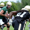 "University of Colorado quarterback Connor Wood hands the ball off to D.D. Goodson during football practice on Monday, Aug. 6, at the CU practice field in Boulder. For more photos of the practice go to  <a href=""http://www.dailycamera.com"">http://www.dailycamera.com</a><br /> Jeremy Papasso/ Camera"