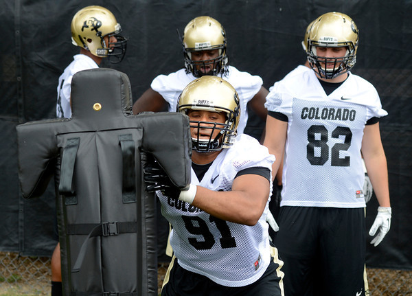 "University of Colorado defensive lineman Kirk Poston hits the sled during football practice on Monday, Aug. 6, at the CU practice field in Boulder. For more photos of the practice go to  <a href=""http://www.dailycamera.com"">http://www.dailycamera.com</a><br /> Jeremy Papasso/ Camera"