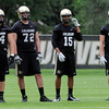 "University of Colorado's Brad Cotner, No. 64, Marc Mustoe, No. 72, Vincent Hobbs, No. 15, and Sean Irwin, No. 81, during football practice on Monday, Aug. 6, at the CU practice field in Boulder. For more photos of the practice go to  <a href=""http://www.dailycamera.com"">http://www.dailycamera.com</a><br /> Jeremy Papasso/ Camera"