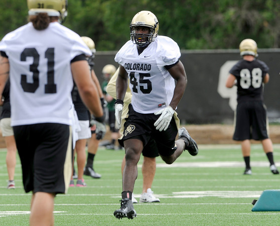 "University of Colorado's Lowell Williams, No. 45, runs a drill during football practice on Monday, Aug. 6, at the CU practice field in Boulder. For more photos of the practice go to  <a href=""http://www.dailycamera.com"">http://www.dailycamera.com</a><br /> Jeremy Papasso/ Camera"