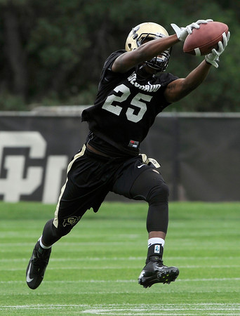 "University of Colorado receiver Gerald Thomas makes a catch during football practice on Monday, Aug. 6, at the CU practice field in Boulder. For more photos of the practice go to  <a href=""http://www.dailycamera.com"">http://www.dailycamera.com</a><br /> Jeremy Papasso/ Camera"