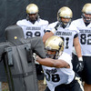 "University of Colorado defensive lineman Andre Nichols hits the sled during football practice on Monday, Aug. 6, at the CU practice field in Boulder. For more photos of the practice go to  <a href=""http://www.dailycamera.com"">http://www.dailycamera.com</a><br /> Jeremy Papasso/ Camera"