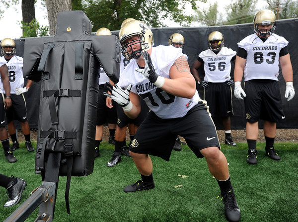 "University of Colorado defensive lineman Eric Richter hits the sled during football practice on Monday, Aug. 6, at the CU practice field in Boulder. For more photos of the practice go to  <a href=""http://www.dailycamera.com"">http://www.dailycamera.com</a><br /> Jeremy Papasso/ Camera"