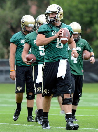 "University of Colorado quarterback Nick Hirschman, front, waits with the other quarterbacks for his turn in passing drills during football practice on Monday, Aug. 6, at the CU practice field in Boulder. For more photos of the practice go to  <a href=""http://www.dailycamera.com"">http://www.dailycamera.com</a><br /> Jeremy Papasso/ Camera"