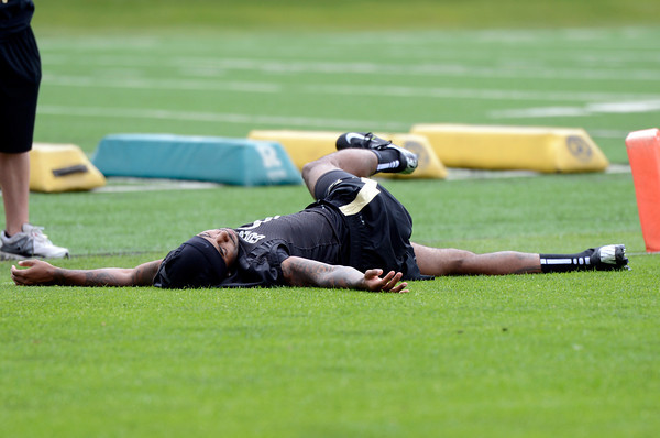 "University of Colorado's Paul Richardson stretches on the sideline during football practice on Monday, Aug. 6, at the CU practice field in Boulder. For more photos of the practice go to  <a href=""http://www.dailycamera.com"">http://www.dailycamera.com</a><br /> Jeremy Papasso/ Camera"