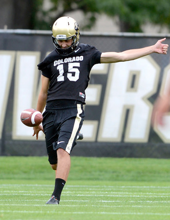 "University of Colorado punter Zach Grossnickle punts the ball during football practice on Monday, Aug. 6, at the CU practice field in Boulder. For more photos of the practice go to  <a href=""http://www.dailycamera.com"">http://www.dailycamera.com</a><br /> Jeremy Papasso/ Camera"
