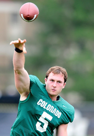 CU quarterback Connor Wood throws the ball during practice at the University of Colorado in Boulder, Colorado August 9, 2012.  DAILY CAMERA MARK LEFFINGWELL