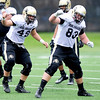 CU defensive linemen Kory Rasmussen (left) and Will Pericak (right) warm up during practice at the University of Colorado in Boulder, Colorado August 9, 2012.  DAILY CAMERA MARK LEFFINGWELL