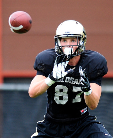 CU wide receiver Tyler McCulloch catches a pass during practice at the University of Colorado in Boulder, Colorado August 9, 2012.  DAILY CAMERA MARK LEFFINGWELL