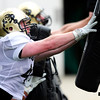 CU linebacker Clayton Jones shoves  the bag during practice at the University of Colorado in Boulder, Colorado August 9, 2012.  DAILY CAMERA MARK LEFFINGWELL