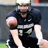 CU wide receiver Justin Gorman catches a pass during practice at the University of Colorado in Boulder, Colorado August 9, 2012.  DAILY CAMERA MARK LEFFINGWELL