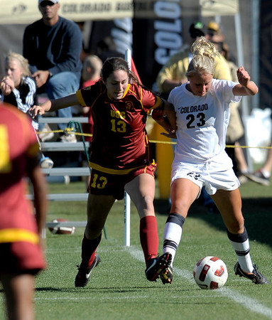 Colorado's Anne Stuller (right) fights USC's Kristina Noriega for the ball during their soccer game at Prentup Field in Boulder, Colorado October 30, 2011.  CAMERA/Mark Leffingwell