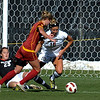 USC's Ashley Freyer (middle) dodges around Colorado's Kayla Millar (left) and Amy Barczuk (right) to score during their soccer game at Prentup Field in Boulder, Colorado October 30, 2011.  CAMERA/Mark Leffingwell