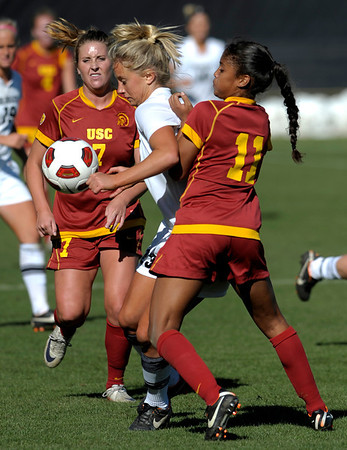 Colorado's Anne Stuller (middle) is pressured by USC's Carly Butcher (left) and Autumn Altamirano (right) during their soccer game at Prentup Field in Boulder, Colorado October 30, 2011.  CAMERA/Mark Leffingwell