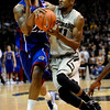 Colorado's Cory Higgins (right) fights past Kansas' Marcus Morris (left) during their game at the University of Colorado in Boulder, Colorado January 24, 2011.  CAMERA/Mark Leffingwell