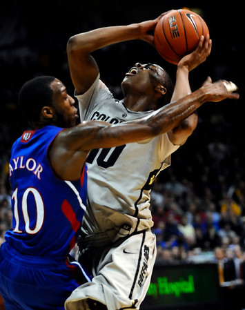Kansas' Tyshawn Taylor (left) fouls Colorado's Alec Burks (right) during their game at the University of Colorado in Boulder, Colorado January 24, 2011.  CAMERA/Mark Leffingwell