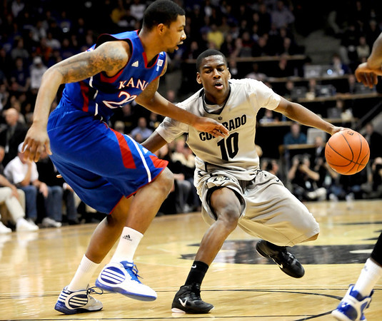 Colorado's Alec Burks (right) tries to get past Kansas' Marcus Morris (left) during their game at the University of Colorado in Boulder, Colorado January 24, 2011.  CAMERA/Mark Leffingwell
