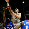 Colorado's Marcus Relphorde (right) shoots over Kansas' Mario Little (left) during their game at the University of Colorado in Boulder, Colorado January 24, 2011.  CAMERA/Mark Leffingwell
