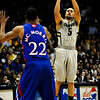 Colorado's Marcus Relphorde (right) takes a three-point shot over Kansas' Marcus Morris (right) during their game at the University of Colorado in Boulder, Colorado January 24, 2011.  CAMERA/Mark Leffingwell