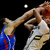 Colorado's Alec Burks (right) gets fouled by Kansas' Markieff Morris (left)during their game at the University of Colorado in Boulder, Colorado January 24, 2011.  CAMERA/Mark Leffingwell