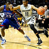 Colorado's Cory Higgins (right) drive past Kansas' Mario Little (left)during their game at the University of Colorado in Boulder, Colorado January 24, 2011.  CAMERA/Mark Leffingwell