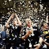 Brian Weikmann (cq)(left), junior in finance, and J.P. Lefever (cq)(right) cheer and throw torn paper into the air at the start of the Colorado vs Kansas game at the University of Colorado in Boulder, Colorado January 24, 2011.  CAMERA/Mark Leffingwell