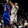 Colorado's Cory Higgins (left) and Kansas' Mario Little (right) go for a rebound during their game at the University of Colorado in Boulder, Colorado January 24, 2011.  CAMERA/Mark Leffingwell