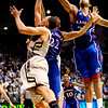 Kansas' Marcus Morris (middle) and Markieff Morris (right) block a shot from Colorado's Marcus Relphorde (left) during their game at the University of Colorado in Boulder, Colorado January 24, 2011.  CAMERA/Mark Leffingwell
