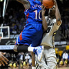 Colorado's Alec Burks (right) is fouled by Kansas' Tyshawn Taylor (left) during their game at the University of Colorado in Boulder, Colorado January 24, 2011.  CAMERA/Mark Leffingwell