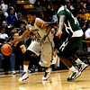 Colorado's Cory Higgins (left) dribbles past Colorado State's Andre McFarland (right) during their game at the University of Colorado in Boulder, Colorado December 8, 2010.  CAMERA/Mark Leffingwell