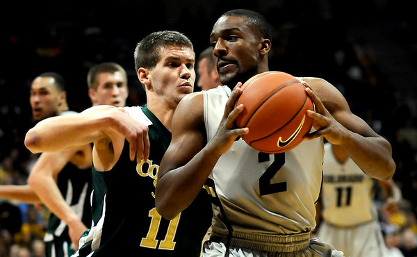 Colorado's Shannon Sharpe (right) looks for an opening while being guarded by Colorado State's Jesse Carr (left) during their game at the University of Colorado in Boulder, Colorado December 8, 2010.  CAMERA/Mark Leffingwell