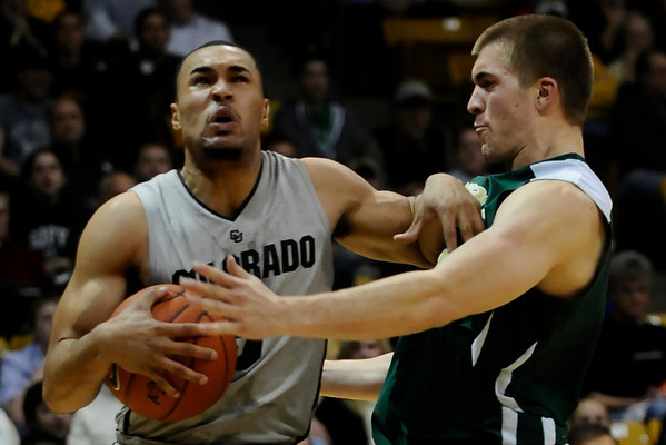Colorado's Marcus Relphorde (left) shoves off of Colorado State's Pierce Hornung (right) during their game at the University of Colorado in Boulder, Colorado December 8, 2010.  CAMERA/Mark Leffingwell