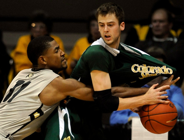 Colorado's Cory Higgins (left) knocks the ball away from Colorado State's Wes Eikeier (right) during their game at the University of Colorado in Boulder, Colorado December 8, 2010.  CAMERA/Mark Leffingwell