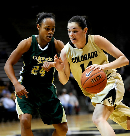 Colorado's Meagan Malcolm-Peck (right) dribbles past Colorado State's Chantel Kennedy (left) during their game at the University of Colorado in Boulder, Colorado December 8, 2010.  CAMERA/Mark Leffingwell