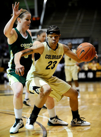Colorado's Chucky Jeffery (right) looks to move the ball toward the hoop while being guarded by Colorado State's Kim Mestdagh (left)during their game at the University of Colorado in Boulder, Colorado December 8, 2010.  CAMERA/Mark Leffingwell